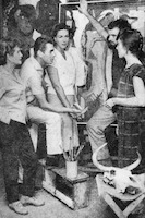 Brisbane artists discussing a contemporary painting at the Churcher studio, Kangaroo Point, Brisbane, 1961